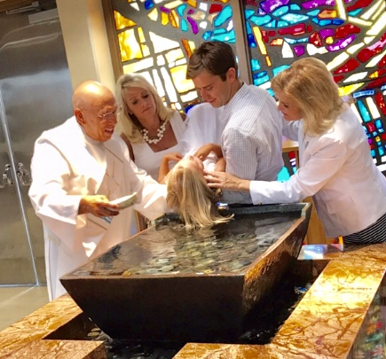 Another picture of Sophia Receiving the Sacrament of Baptism (being dunked!)